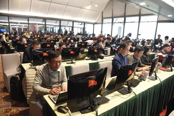 Trung tâm Báo chí Đại hội XIII sôi động trong ngày đầu diễn ra Đại hội
